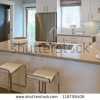 stock-photo-interior-design-of-a-luxury-modern-kitchen-with-two-sits-and-the-dish-with-some-pears-on-the-118758406