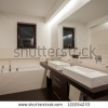 stock-photo-travertine-house-cream-and-brown-color-in-bathroom-122294233